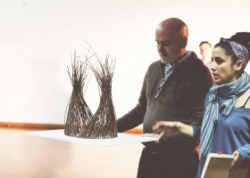 Stephen-stanging-next-to-Sarah-Vyne-holding-his-model-desing-of-the-bowerbirds-nest