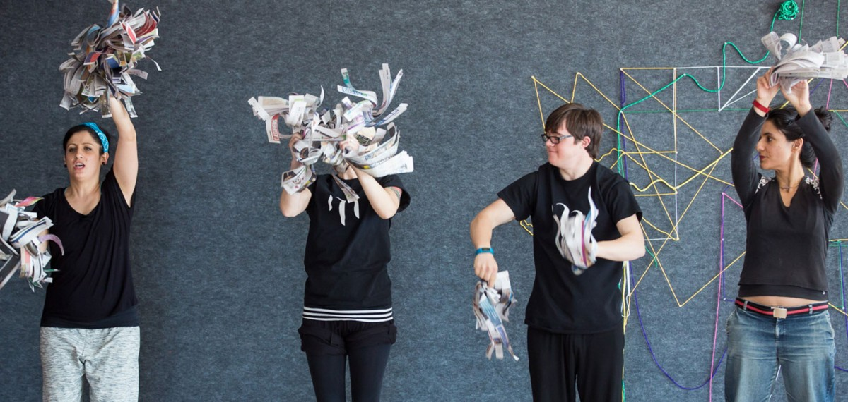 Workshop-at-Museum-of-Contemporary-Art.-A-group- of Murmuration-artist-shaking-torn-up-strips-of-newspaper.-Bella-Room-Photographer-Maja-Baska