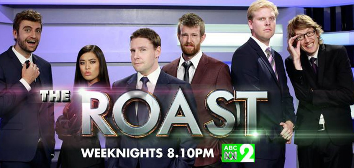 A-promotional-shot-for-the-TV-show-The-Roast-5-guys-a-woman-standing-side-by-side-with-theatrical-expressions-the-roast-logo-on-top-of-them