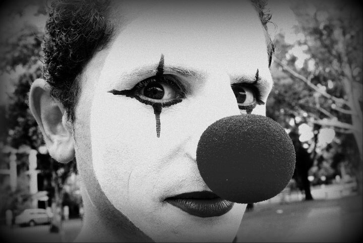 Close up of jordan with his face painted as a clown (Black and White Photo)